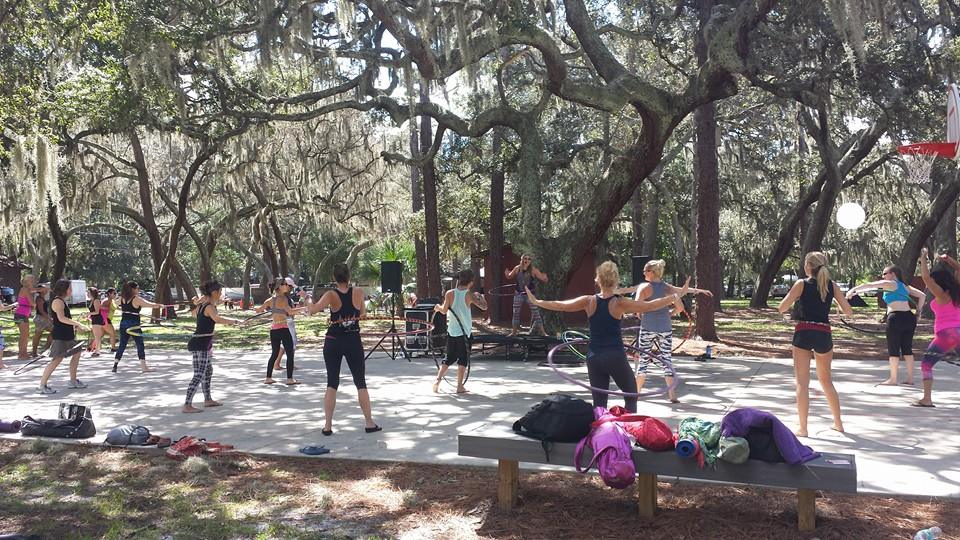Abby Teaching Hoola-Fit under the mossy oak trees